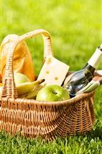 Basket, bread, wine, apple, banana, green grass