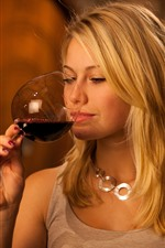 Blonde girl drink red wine