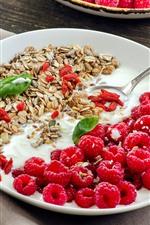 Delicious breakfast, yogurt, muesli, red raspberry