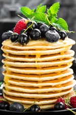 Delicious pancakes, many layers, honey, blueberries