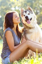 Happy girl and husky dog, grass, summer