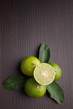 Limes, fruit, wood background