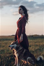 Red skirt girl and dog, meadow