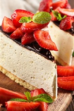 Some pieces of cheese cake, chocolate, strawberry