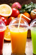 Three cups of juice, colors, fruit