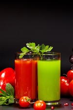 Two cups of juice, tomatoes, grapes, peppers
