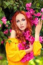 Beautiful girl and bougainvillea