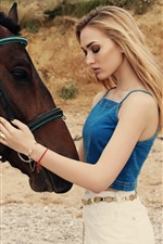 Blonde girl and brown horse, summer