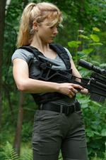Preview iPhone wallpaper Blonde girl, sniper rifle, forest