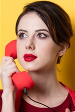 Preview iPhone wallpaper Girl use telephone, yellow background