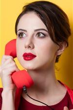 Girl use telephone, yellow background