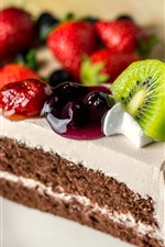 One piece of cake, fruit slice, kiwi, strawberry