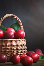 Red plums, delicious fruit, basket