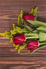 Red tulips, bouquet, wood board