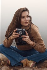 Preview iPhone wallpaper Brown hair girl, camera, sweater