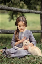 Cute girl and cat, fence