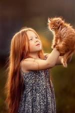 Cute little girl and furry kitten
