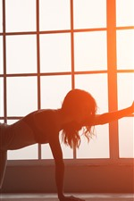 Preview iPhone wallpaper Fitness girl, pose, window, backlight, glare