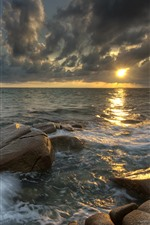 Sea, thick clouds, rocks, sunset