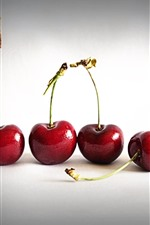 Some red cherries, white background