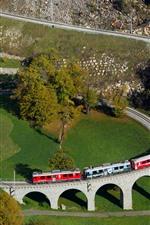 Preview iPhone wallpaper Switzerland, spiral viaduct, train, village