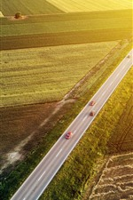 Preview iPhone wallpaper Top view, green fields, cars, road