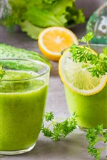 Two cups of smoothies, lemon, cucumbers