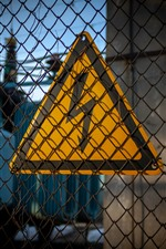 Preview iPhone wallpaper Wire fence, electricity warning sign