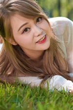 Preview iPhone wallpaper Beautiful Asian girl, smile, grass, freedom