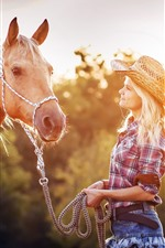 Blonde girl and horse, sun rays, summer