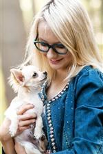 Blonde girl, glasses, dog