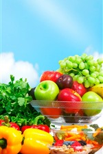 Fresh fruits, grapes, apples, tomatoes, juice, blue sky
