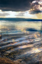 Preview iPhone wallpaper Lake, reeds, clouds, dusk, rocks, sun rays