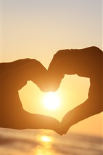 Preview iPhone wallpaper Love heart, hand, sun, glare