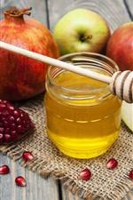 Romã, maçãs, mel