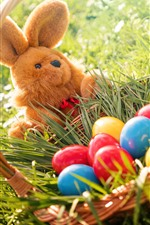 Preview iPhone wallpaper Colorful eggs, rabbit toy, grass, basket, Easter