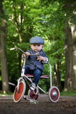 Preview iPhone wallpaper Cute little boy, child, toy bike
