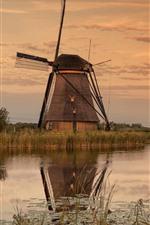 Windmills, river, village