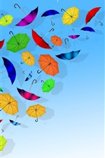 Colorful umbrellas, blue background, creative picture