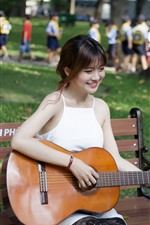 Preview iPhone wallpaper Happy girl play guitar, bench, park