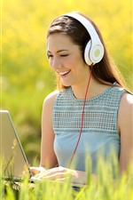 Preview iPhone wallpaper Happy girl use notebook, headphone, grass, summer