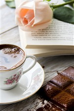 One cup of tea, chocolate, pink rose, book