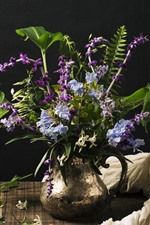 Purple and blue flowers, vase, black background