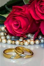 Red roses, wedding rings, pearl
