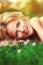 Preview iPhone wallpaper Smile blonde girl lying on the grass