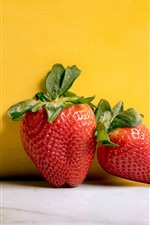 Preview iPhone wallpaper Two strawberries, yellow background