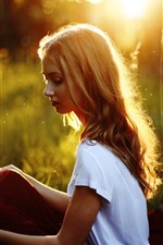 Preview iPhone wallpaper Blonde girl, sit, grass, sunshine, glare, summer