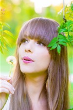 Preview iPhone wallpaper Long hair girl, dandelion, green foliage