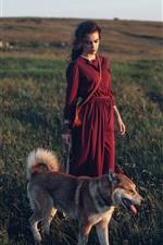 Red skirt girl, dog, grass