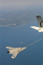Preview iPhone wallpaper Unmanned, plane, refueling in sky